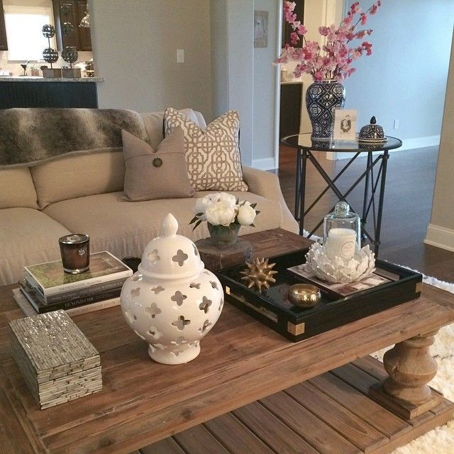 Love that coffee table. The rest is pretty but wouldn't last 2 seconds with a toddler around.