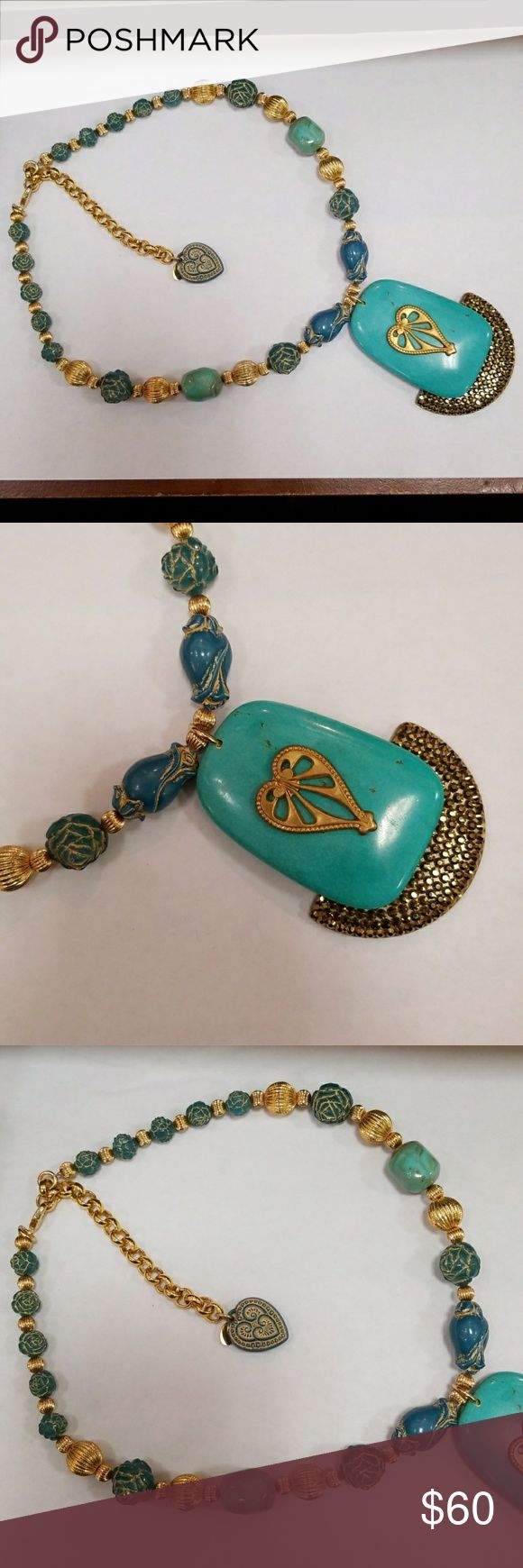 Original Tarina Tarantino Turquoise Heart Necklace Stunning!!! This is a turquoise and gold Lucite necklace. Features turquoise rose beads and gold ball beads. The medallion hanging is made out if turquoise looking stone with heart center and gold  Sworvaski Crystal semi circle attached. Claw Clasp with dangle heart . This piece is sizeable. The detail in this necklace is Amazing! just look Tarina Tarantino Jewelry Necklaces
