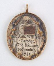 A double-sided mourning locket for St Robert William, who died in 1745, painted on vellum, with a tomb, skull and crossbones depicted (the other side marks to his birth). (imageevent.com)