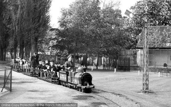 The train at Chessington Zoo, 1965. Chessington Zoo opened in 1931; it was started by Reginald Goddard, who had bought the estate to showcase his private collection of animals. In 1946 when Goddard died, the Pearson Publishing Company took over the zoo and managed it until 1978, when The Tussauds Group took control of the park. #zoo #history #photography