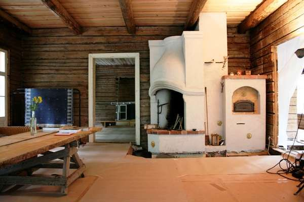 House built of old logs in Finland, with old oven