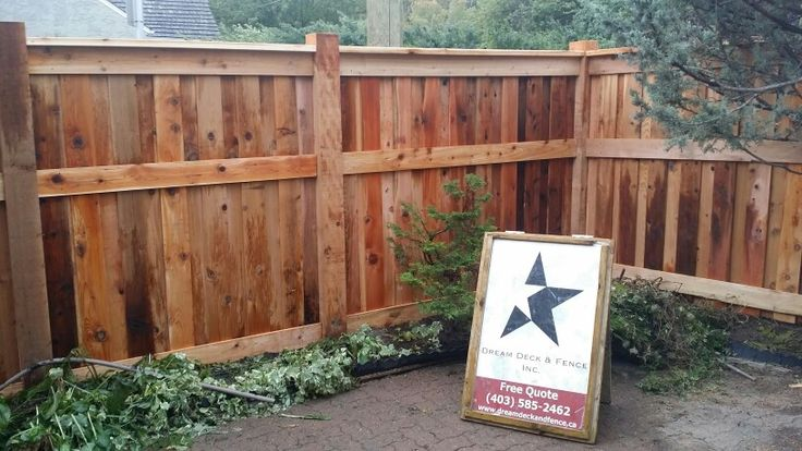 Custom Cedar Fence 6x6 posts full privacy fence boards over lapped no spaces........