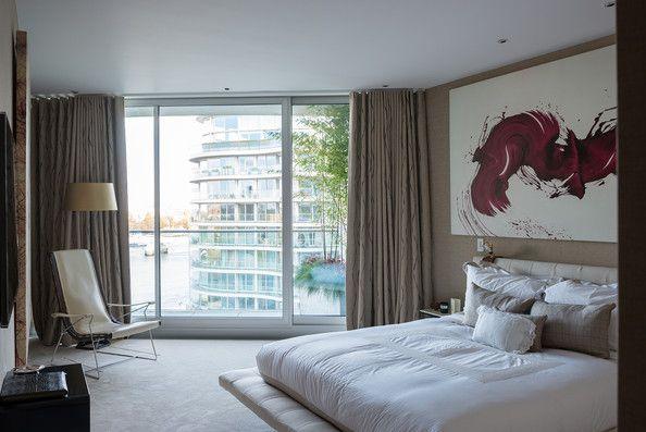 An Onda platform bed by Poliform and a work by James Nares in the master bedroom of London designer Tara Bernerd