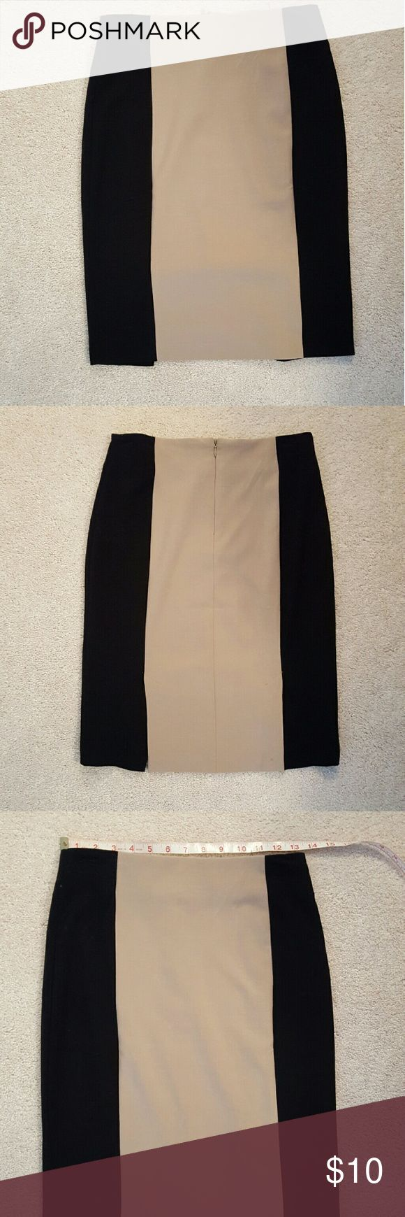 Black and tan pencil skirt Black and tan pencil skirt. Stretches to accentuate your curves. Very flattering. Looks great with a simple tank and statement necklace. Skirts Pencil