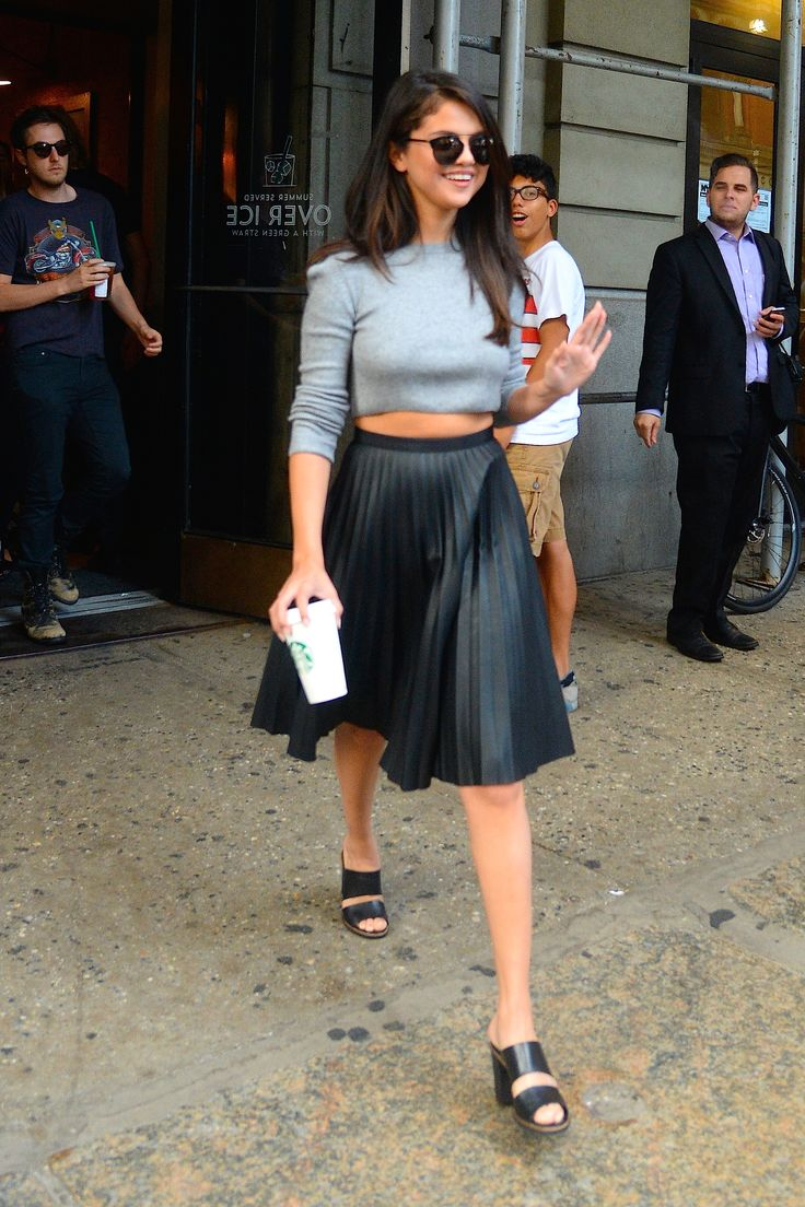Gomez strolls around in Soho wearing a cropped grey top and pleated leather skirt.    - HarpersBAZAAR.com
