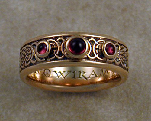 8th to 9th century Celtic wedding band with bezel set cabochon garnet stones.