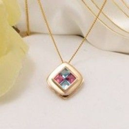 Topaz & Tourmaline Gemstone Pendant  Surrounded by 9 Ct Gold. Elegant blue and pink gem pendant featuring 2 genuine Topaz & 2 solid Tourmaline's. Perfect gift idea for her.