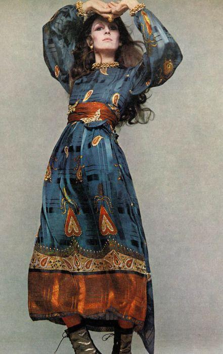 Anjelica Huston photographed by Richard Avdeon for Vogue, 1970 vintage fashion color photo print ad models magazine designer bohemian peasant long silk print dress blue brown tan boba like belted long sleeves 70s