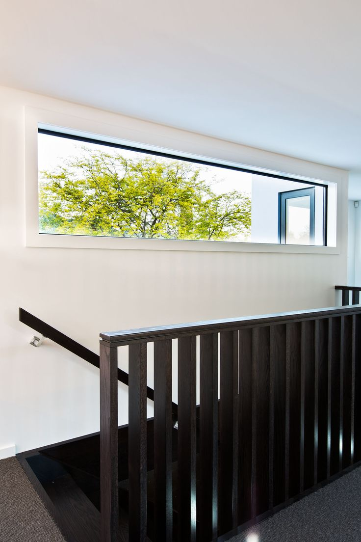 A window to let in light, but to retain privacy at the top of the stairs.