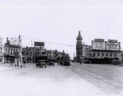 St Kilda Junction advertising Palais & Victory Theatres 1930