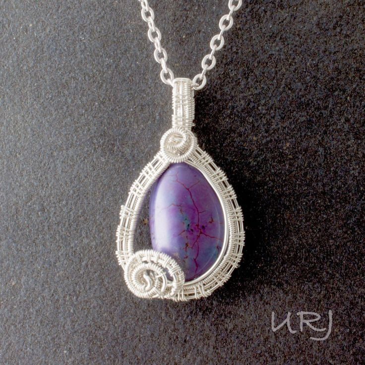 Delphica wire wrapped pendant with negative space by Magenta