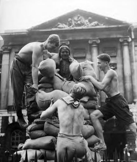 British teenagers sandbagging a British monument out front of the British Museum, London 1939