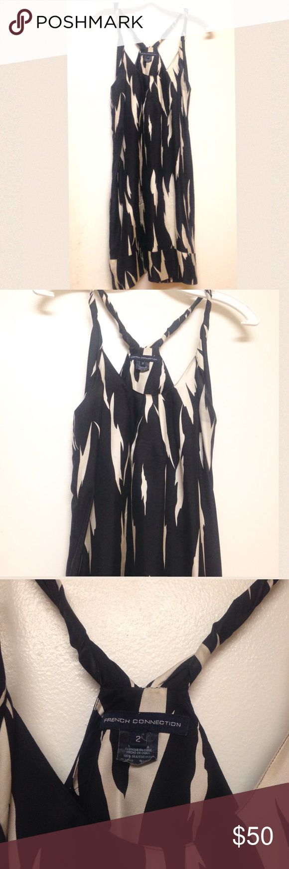 French connection animal print cocktail dress Black and white animal print above-the-knee address. 100% silk. Never worn, no tags. A great feature is the hidden pockets on both sides. NO RETURNS! -Please ask all questions before purchase. I will answer honestly and accommodate almost any request. ** free gift with every shipment! ** ❤️ French Connection Dresses Midi