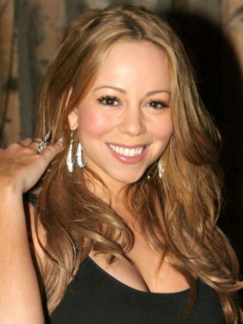 Mimi wins an impressive 3 Grammys in 2006!