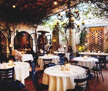 The Little Door, Los Angeles    L.A.'s Little Door may as well be called The Secret Garden—its intimate patio, accessed through rustic wooden doors, is filled with bougainvilleas and has a tiled fountain and koi pond.