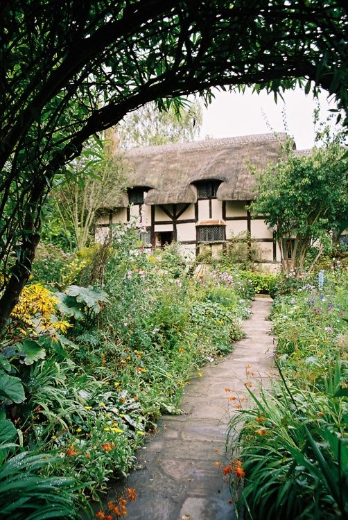 """Anne Hathaway's cottage----This is the most charming of all the Birthplace Trust's properties, not only is it tinged with romance as the place where William Shakespeare courted the young girl who was to become his wife, but it nestles in the most idyllic of English surroundings. The cottage is located in the village of Shottery, and although referred to as a cottage in reality it is a substantial house. The fact that the Hathaway's were a prosperous family is reflected by the house."