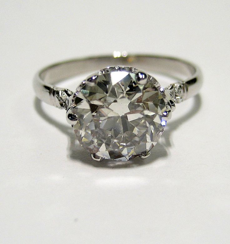 2.43ct Antique Vintage OLD EUROPEAN ROUND Cut Diamond Engagement Ring. $12,895.00, via Etsy. (too much bling for me, but i love the vintage)