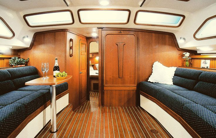 Down below of Island Oacket 485, the natural light floods the cabin as you enter the main salon. Both the port and starboard hulls are lined with spacious settees, and a dining table drops down from the bulkhead on the starboard side.  See more of her here: