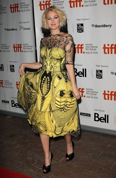 Spectacular Alexander Mcqueen yellow dress worn by Drew Barrymore.     Picture found at stylebistro.com