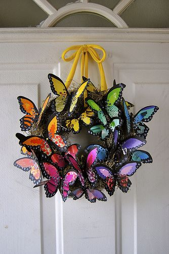 butterfly wreath -Silhouetter template with various cardstock, or Could use butterflies from Dollar Tree and grapefine wreath for a similar look.  May not have as many colors, but would be covered with butterflies
