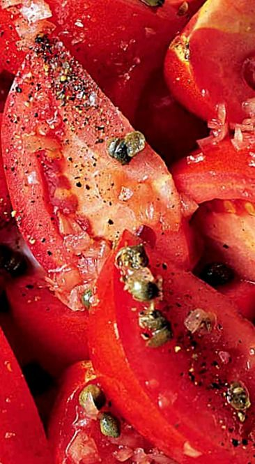 Beefsteak Tomato Salad - a simple steak house-style salad with fresh juicy tomatoes and a wine vinegar and oil dressing. Sometimes, simple is best! ❊