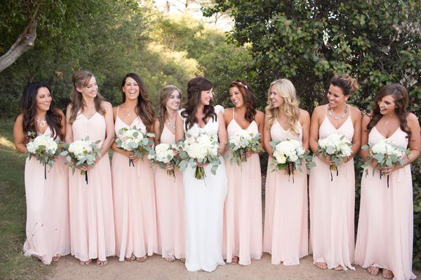 pink bridesmaids dresses - photo by Katrina Louise http://ruffledblog.com/secluded-garden-estate-wedding