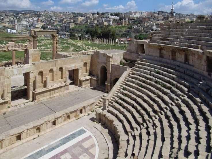 The modern city of Jerash, Jordan, is visible from the North Theater (165 AD) in the Roman archaeological site.