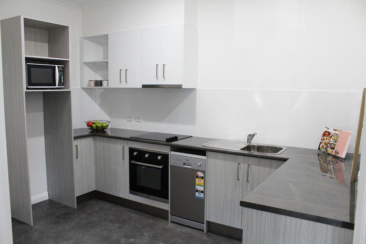 White overheads, Metropolitan Concrete laminate benchtops & Laminex Chalky Teak base cupboards.
