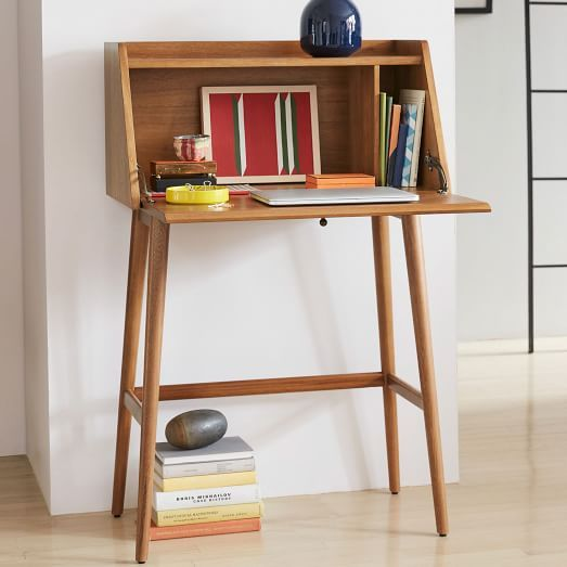 Adaptable and inspired by '50s and '60s furniture designs, our Mid-Century Mini Secretary's smaller, solid FSC®-certified wood frame adds big, vintage-inspired style to your space. A flip down door opens to reveal storage space and a place to perch your laptop.