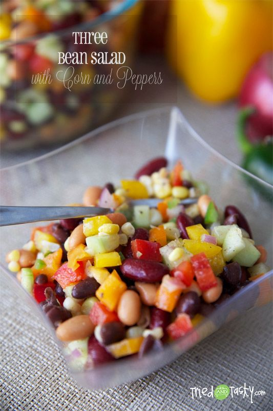 Three Bean Salad with Corn & Peppers // A healthy salad great for any lunch, side dish, BBQ, family gathering, potluck, or any other special occasion. Jam packed with lots of veggies, beans for added nutrition, and a delicious dressing with no sugar! | Tried and Tasty