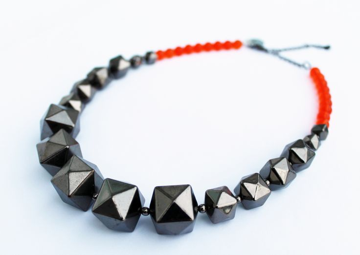 One of a kind geometric necklace. Vintage gunmetal silver geometric beads with bright orange glass beads. Handmade in Wellington, NZ, by Shh by Sadie designer Sadie Hawker. Shhbysadie.com