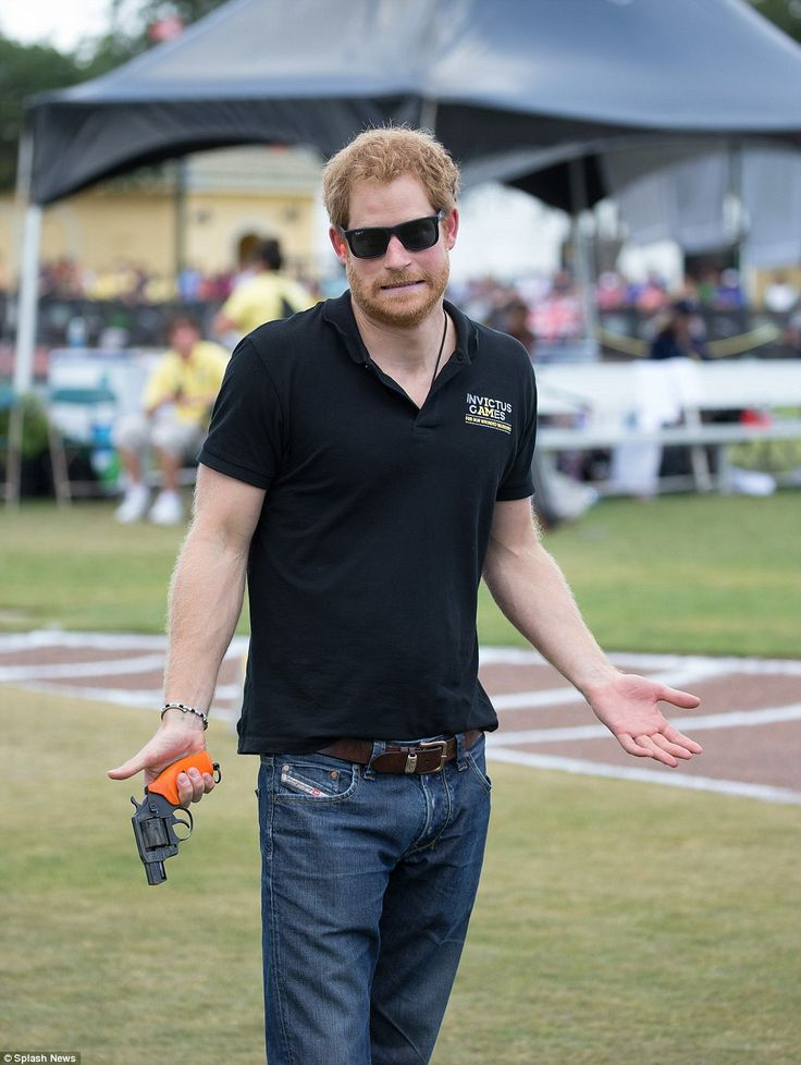 Prince Harry stayed true to his cheeky demeanor today as he pulled faces while firing a starter gun on the second day of The Invictus Games