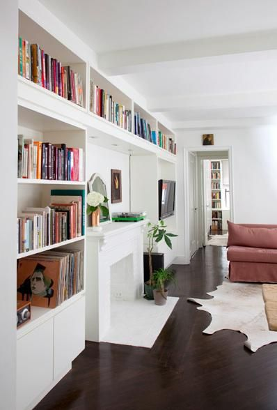 Library: Piano in built in space on interior wall of library encased in bookshelves.  Far bookcase opens into butler pantry