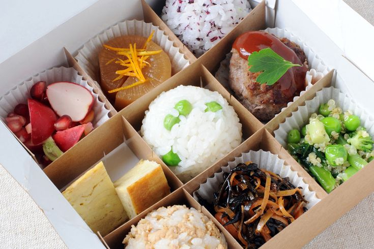 A new Japanese canteen serving bento boxes of omosubi: filled rice balls served with salads and vegetables. Perfect presentation, authentic ...