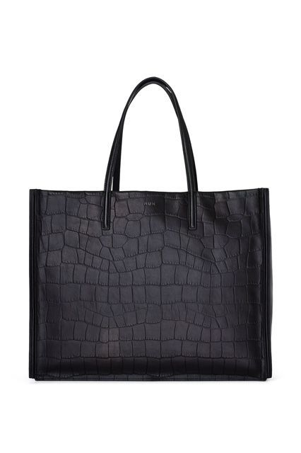 The One Thing To Look For When You're Buying Your Next Tote Bag #refinery29  http://www.refinery29.com/best-tote-bags#slide-12  The thin handle only looks dainty: Made from 100% leather, this tote is tough, armored with sturdy straps and overlay panels to ensure you get from A to B without any setbacks. And, the rectangular shape fits a laptop comfortably, with enough room for other tech goodies and the rest of your must-haves. ...