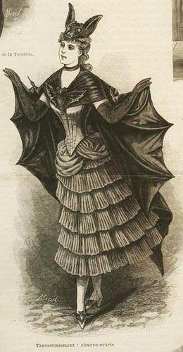 """Victorian bat costume (particolare illustrazione della rivista """"La moda illustrata"""", Sonzogno, 13 gennaio 1887: """"La corta gonnella è provveduta di volante a pieghe e di pezzi di guarnizione fatti di tarlatana grigia pieghettata: il corpetto, che si chiude di dietro, è di raso del colore ora indicato. Lo sciallo e le ali, con ossi di balena, sono di taffettà nero: il primo è trattenuto davanti da un pipistrello di peluzzo. Anche sulle scarpette di raso sono fissati due piccoli pipistrelli"""")"""