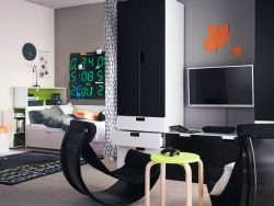A teenage room with black/white bed and storage. Combined with two black balance chairs, comfortable to sit in when playing video games.