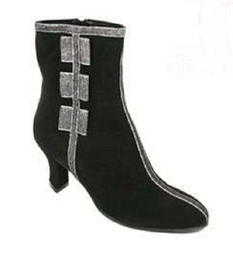 Ron White for Thierry Robotin Suede Ankle Boot Side Bows, Black. Ron White ankle boots are crafted from rich black suede,is accented with metallic silver and black gortex. A stripe runs through the center of the boot, front to back.
