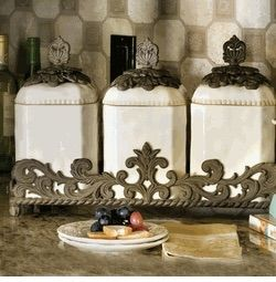 Gg Collection Provencial 3 Piece Textured Cream Ceramic Canister Set With Metal Base