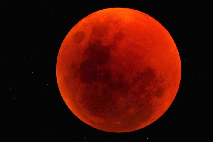 The moon turned a blood red over the Sossusvlei Desert Lodge on NamibRand Nature Reserve in Namibia in this stunning photo taken by skywatcher George Tucker on June 15, 2011. <br />