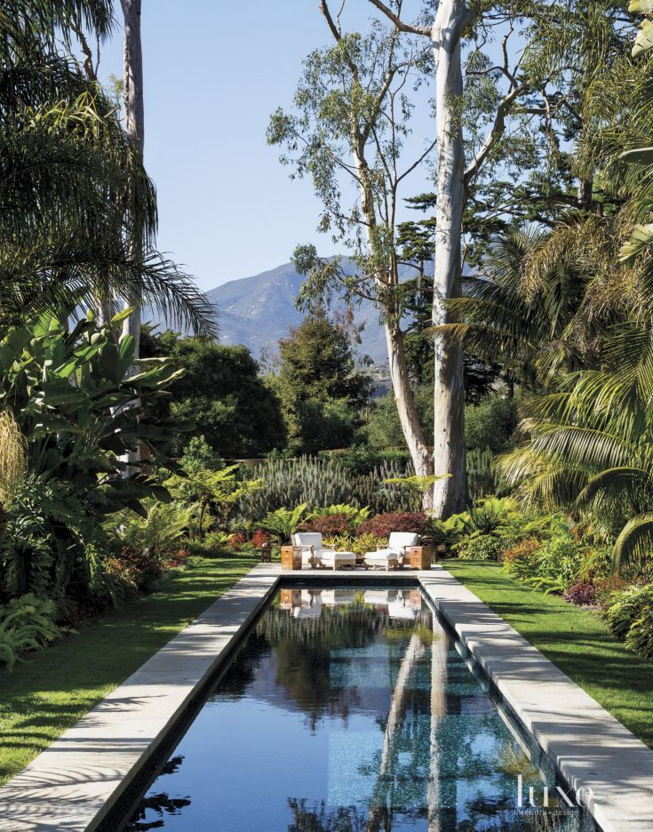 Contemporary Poolside with Lush Gardens