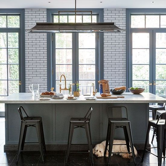 Hard surfaces and simple, practical fittings give this spacious NYC brownstone kitchen  an industrial feel. Viahousetohome.co.uk