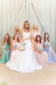 I usually don't like all of the different color bridesmaids dresses, but I love this one.
