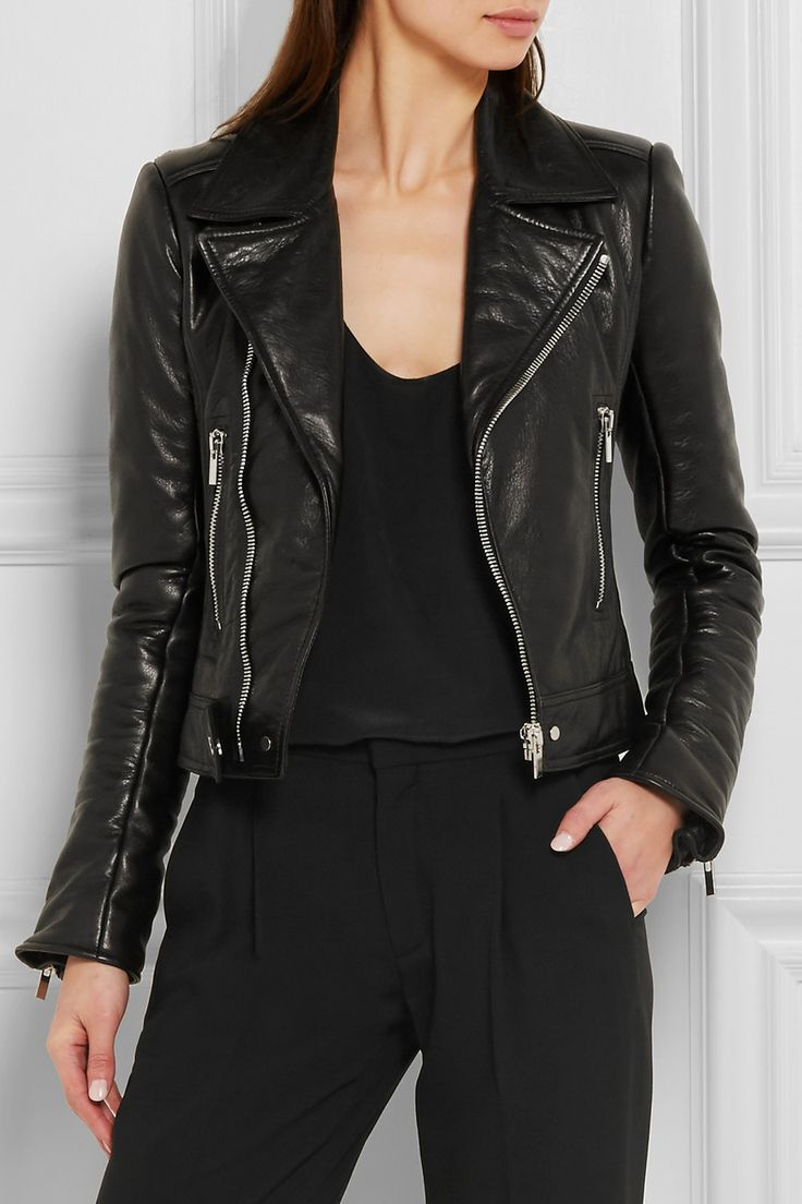 Black leather  Asymmetric zip fastening through front 100% leather (Lamb); lining: 100% rayon Specialist clean