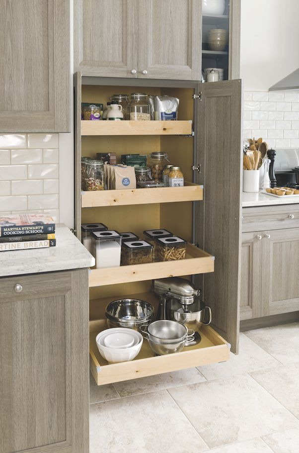Keep all your pantry supplies and snacks within easy reach! This spacious utility pantry with roll trays offers easy access for kitchen cooking staples and large equipment. Shown in the brand new Tipton textured PureStyle™ kitchen, available exclusively from Martha Stewart Living™ at The Home Depot.
