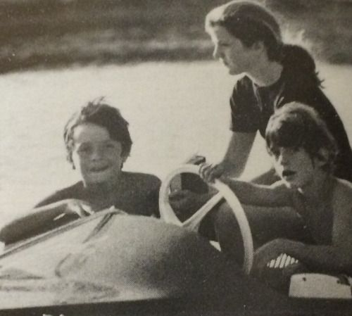 Caroline and John Kennedy with cousin, Anthony Radziwill, in a motorboat at Skorpios.