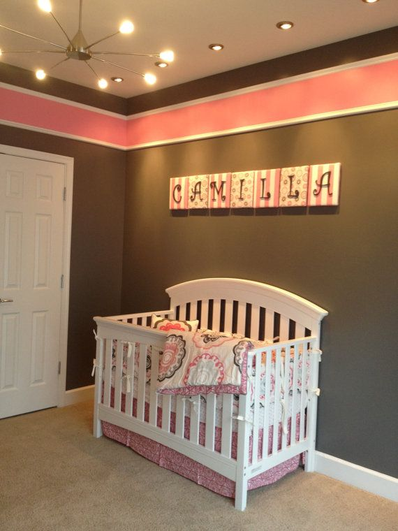 Love the grey walls with pink across the top.