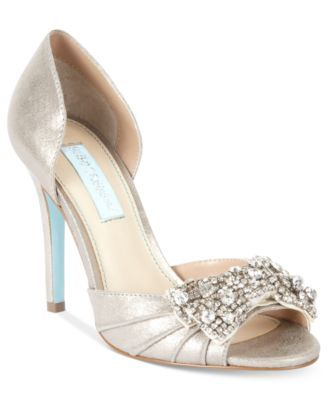 For a moment to a remember. The Gown evening pumps by Something Blue by Betsey Johnson feature a satin upper and a rhinestone bow on the vamp.   Imported   Satin/man-made upper   Round open-toe evenin