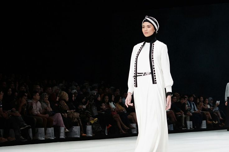 White dress gamis very modern lines from Hannie Hananto collection for Indonesia Fashion Week 2014