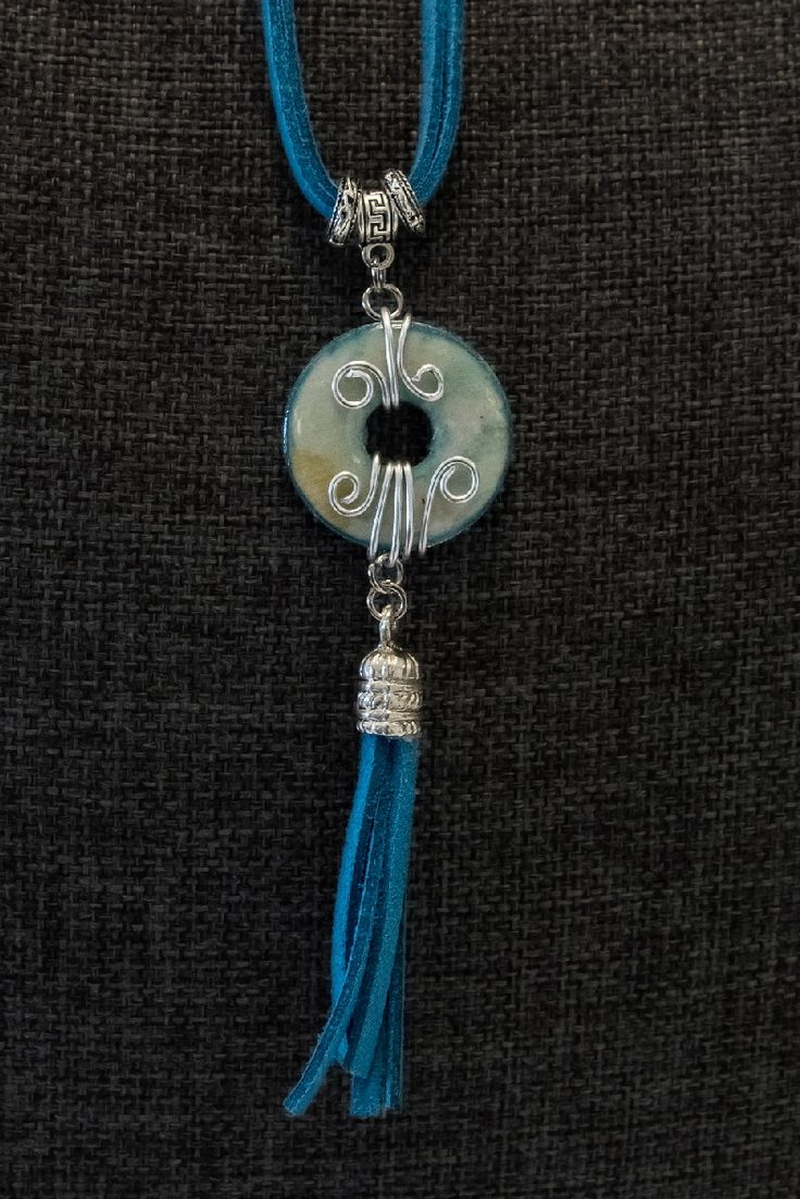Bohemian inspired sea-coloured necklace with turquoise, greens and silver bead enhancements.